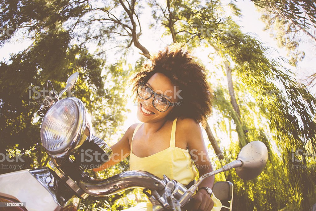 Young nerdy woman on scooter stock photo
