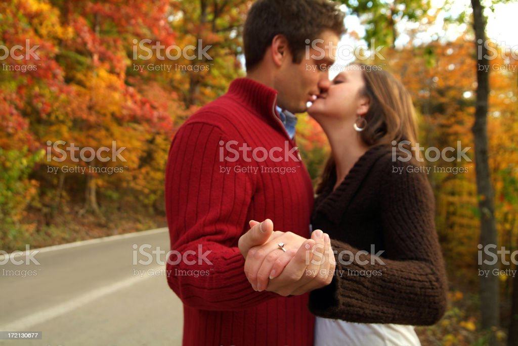 Young Newly Engaged Couple Showing off Her Ring royalty-free stock photo