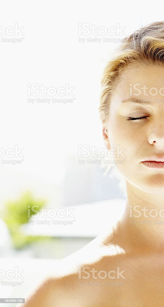 Young nude woman meditating on a sunny day royalty-free stock photo