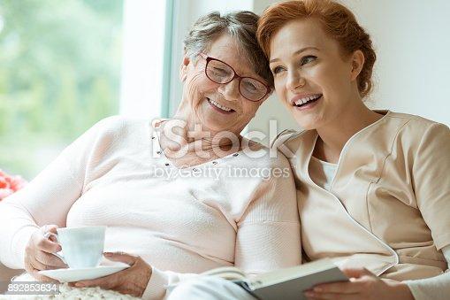 istock Young nurse and elder patient 892853634