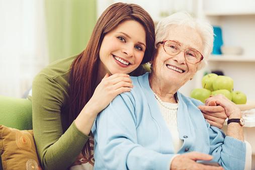 144362548 istock photo Young nurse embracing a happy senior woman 521512635