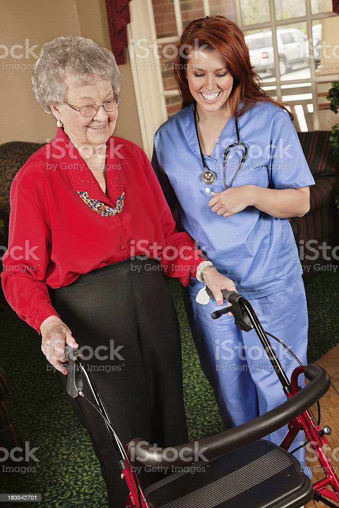 Young Nurse Helping Senior Adult Patient royalty-free stock photo