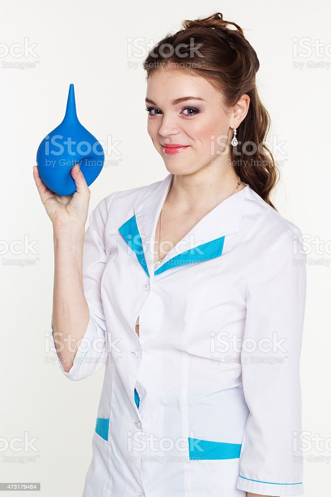 Young nurse with enema in hands stock photo