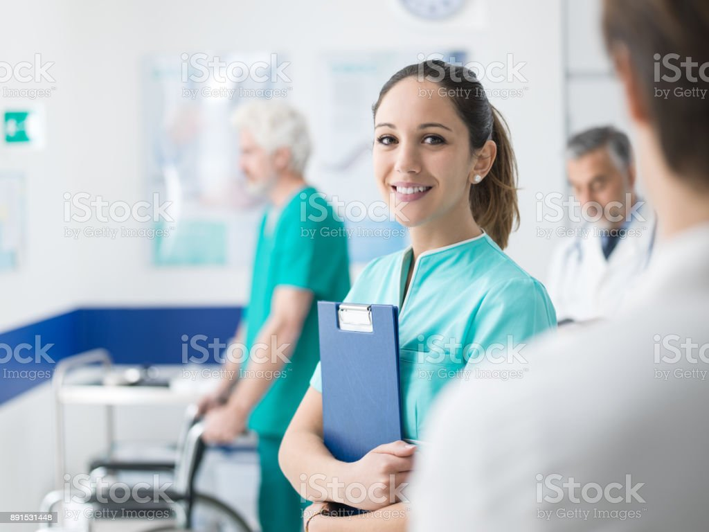 Young nurse working at the hospital stock photo