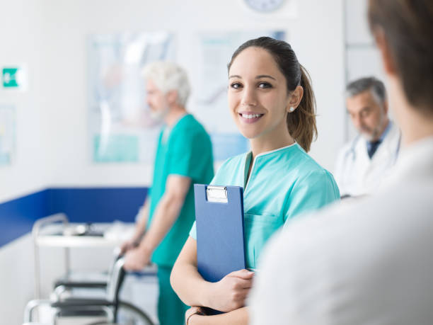 young nurse working at the hospital - nurse stock pictures, royalty-free photos & images
