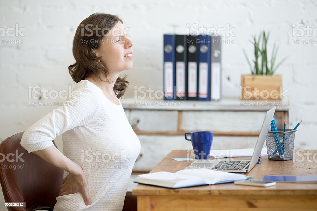 Young office woman feeling backache stock photo