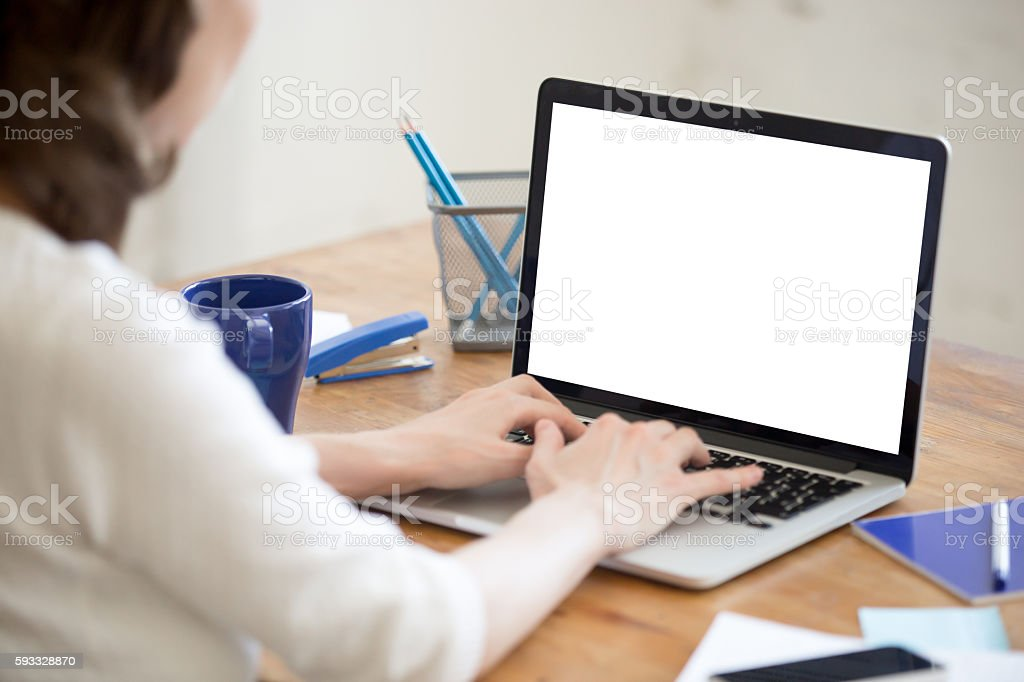 Young office woman typing on laptop. Closeup stock photo