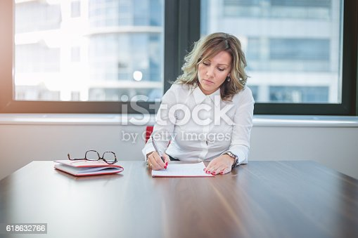 840623374 istock photo young office worker writing , solving problems 618632766