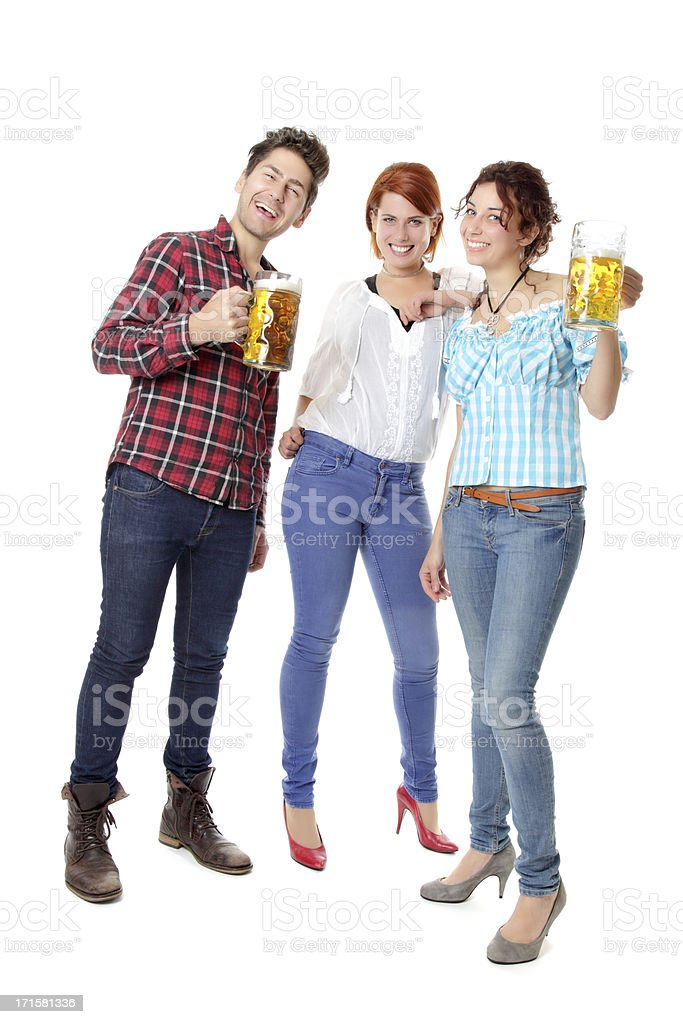 Young Oktoberfest visitors partying with beer steins stock photo