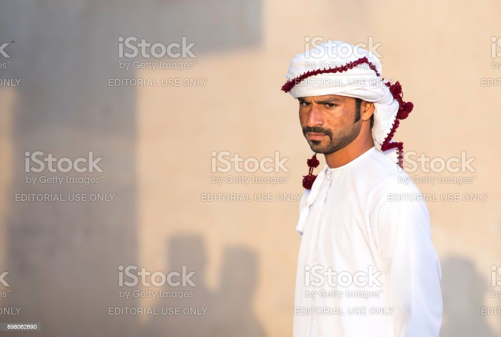 young omani man in traditional clothing at a market stock photo
