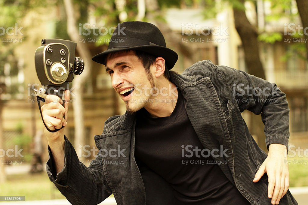 Young operator looks at the old camera royalty-free stock photo