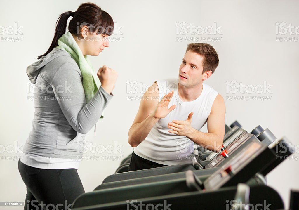 Young Overweight Woman Exercise in a gym. royalty-free stock photo