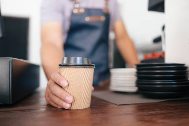 Young owner of coffee cafe service customer. stock photo