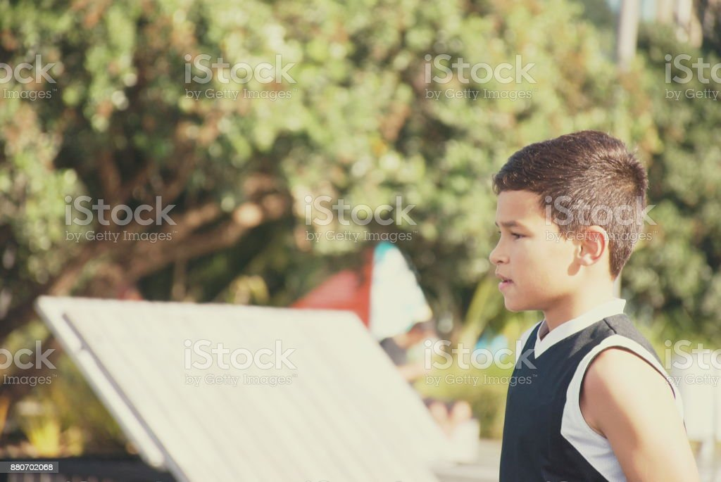 Young Pacific Islander Child in Park Scene stock photo