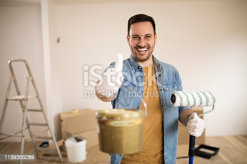 istock Young painter giving thumb up 1139355289