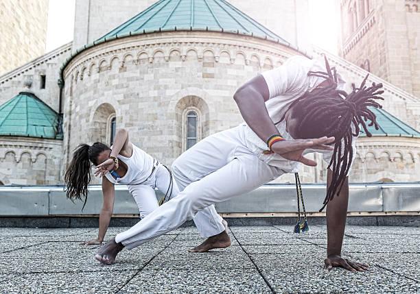 Young pair capoeira partnership ,spectacular sport stock photo