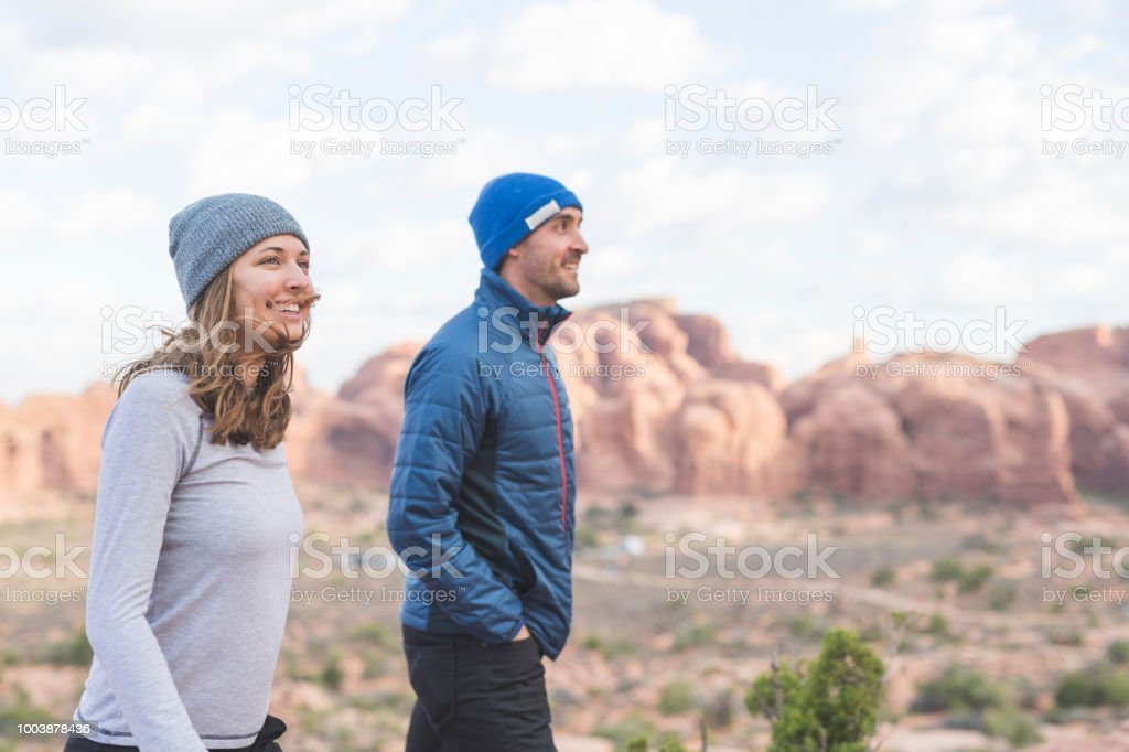 Young pair of hikers enjoy an early morning in the Utah desert stock photo