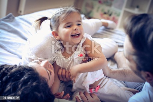 479612990istockphoto Young parents have play with their baby girl. 914859196
