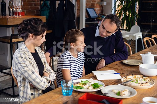 960595148 istock photo Young parents helping their daughter to compose a letter 1222873940