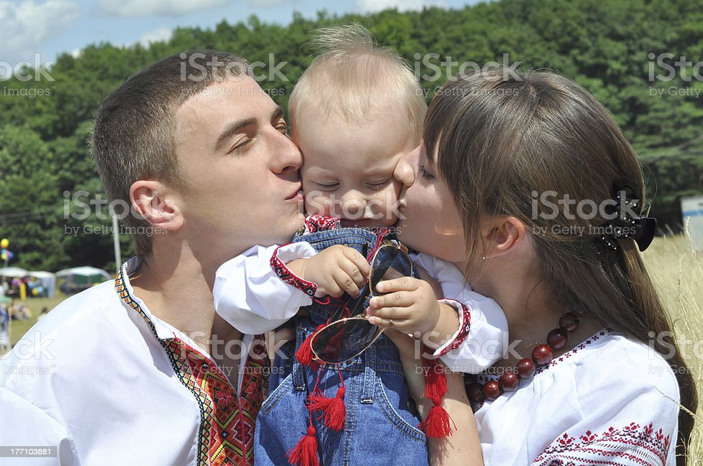Young parents kissing their child royalty-free stock photo