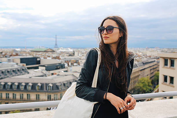 young parisian woman enjoying the view - paris fashion stock photos and pictures