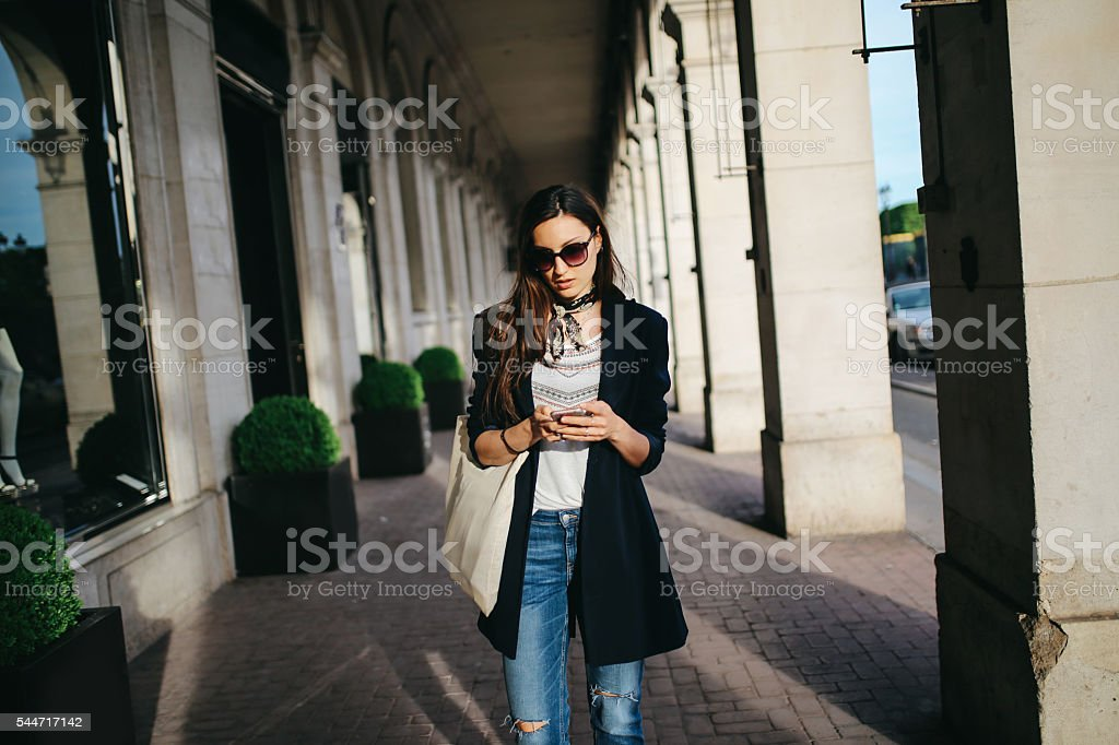 Young Parisian woman on the street stock photo