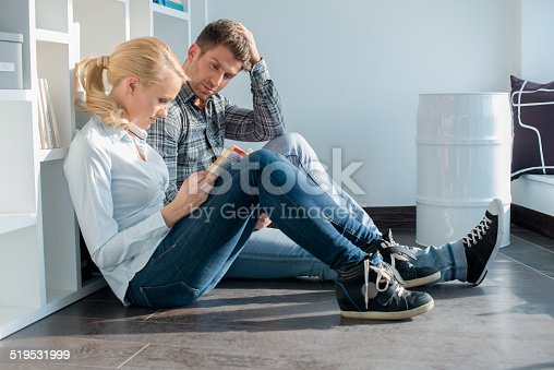 834814926 istock photo Young Partners in Casual Attire Sitting on Floor 519531999