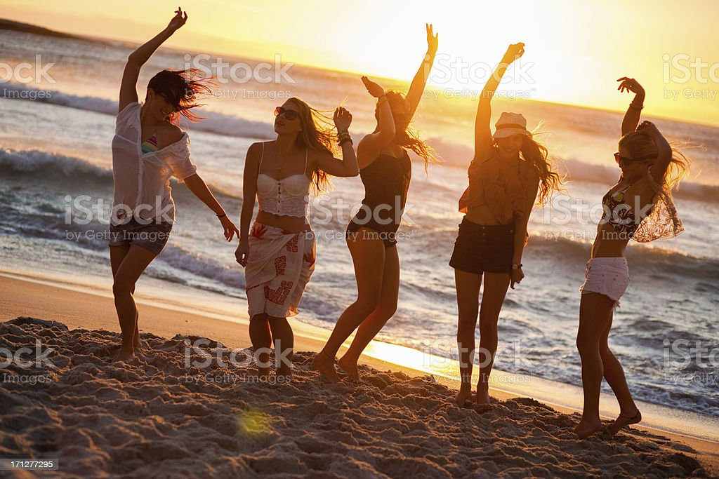 Young Party People dancing at the beach stock photo