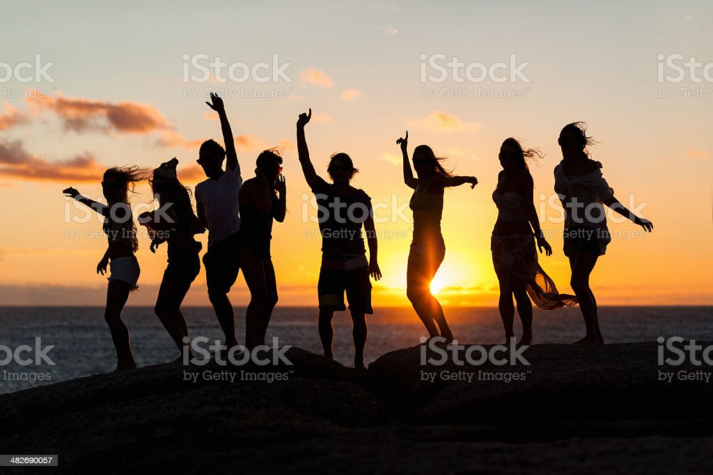 Young Party People Dancing On A Rock stock photo