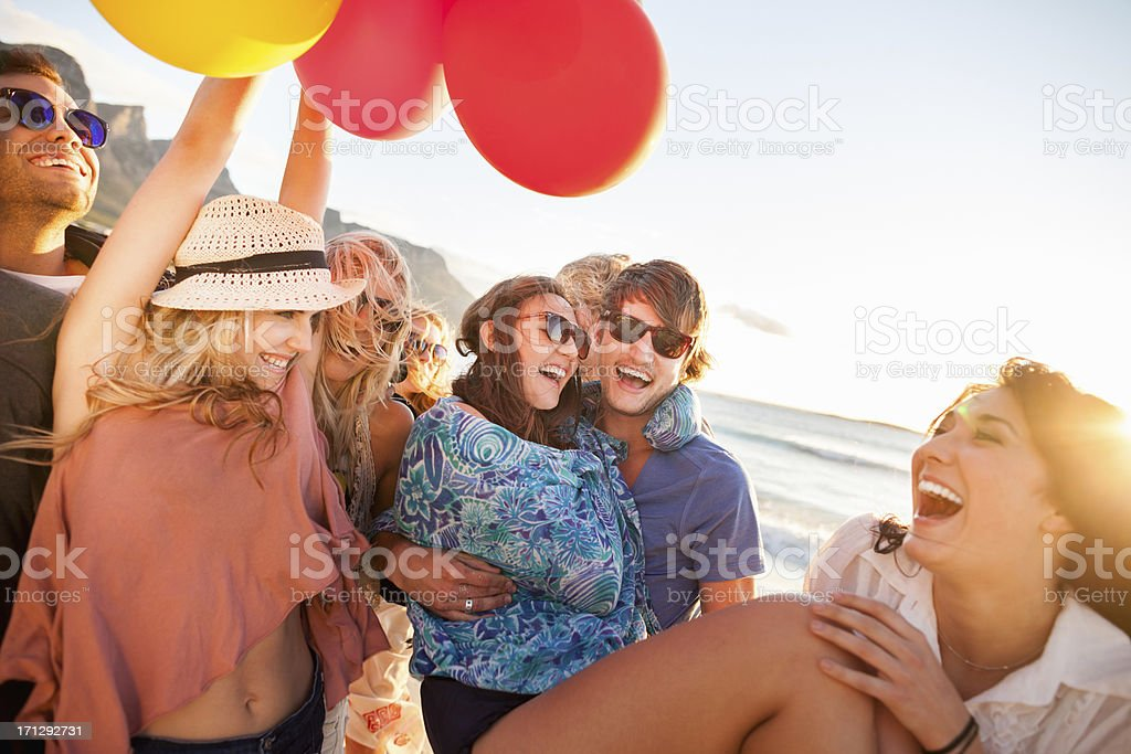 Young Party People having fun at the beach stock photo