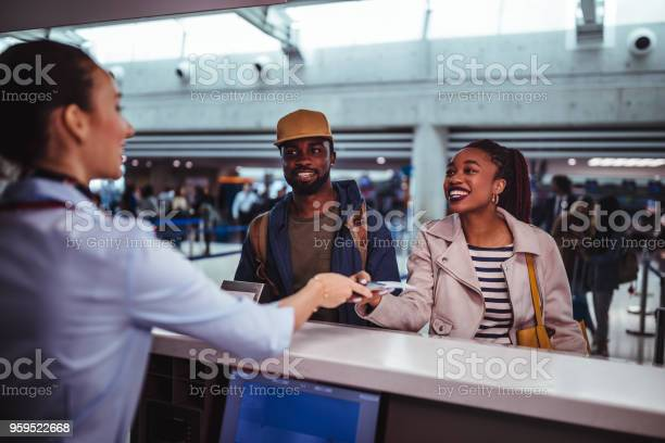 Young passengers doing checkin for flight at airport picture id959522668?b=1&k=6&m=959522668&s=612x612&h=gmmgkqbyyo4j9k xdkma4o3ocsxrc xryfneg4rjxn8=