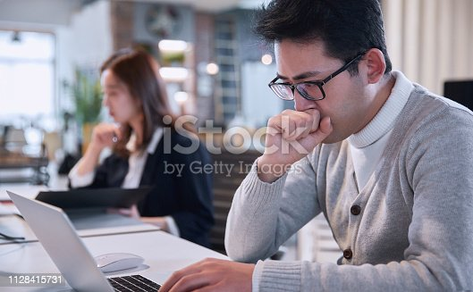 905545264istockphoto Young pensive coworker working 1128415731