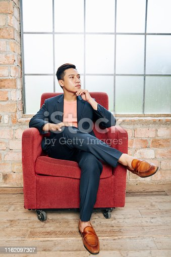 530281723istockphoto Young pensive entrepreneur 1162097307