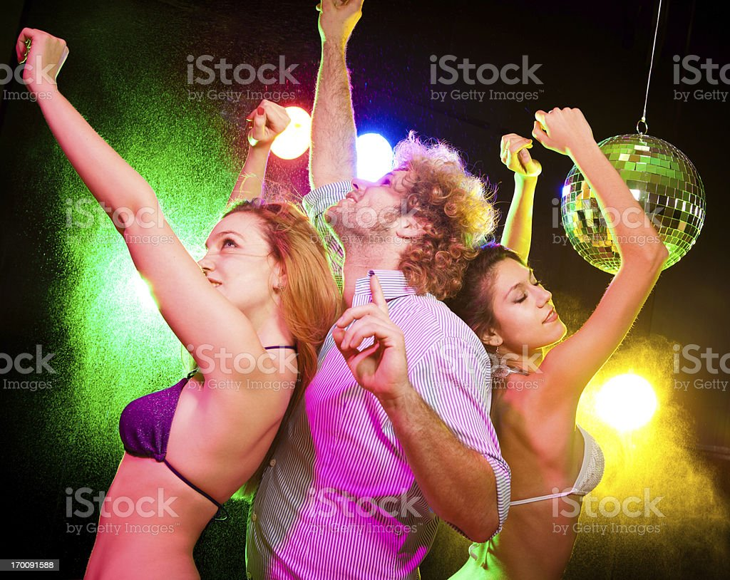 Young people are having fun in the disco royalty-free stock photo