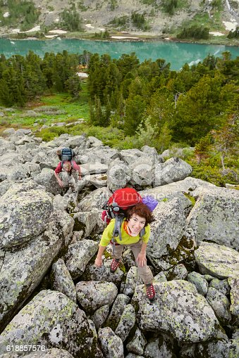 istock Young people are hiking in highlands of Altai mountains, Russia 618857576