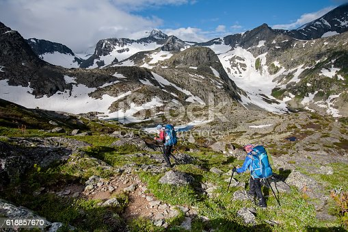 istock Young people are hiking in highlands of Altai mountains, Russia 618857670