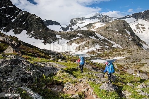 istock Young people are hiking in highlands of Altai mountains, Russia 618857752