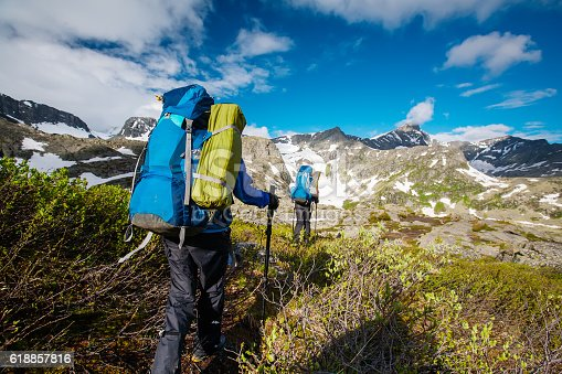 istock Young people are hiking in highlands of Altai mountains, Russia 618857816