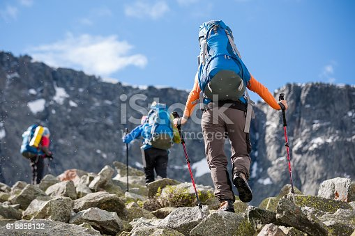 istock Young people are hiking in highlands of Altai mountains, Russia 618858132