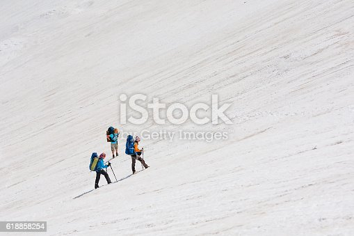 istock Young people are hiking in highlands of Altai mountains, Russia 618858254