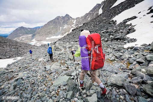istock Young people are hiking in highlands of Altai mountains, Russia 618858632