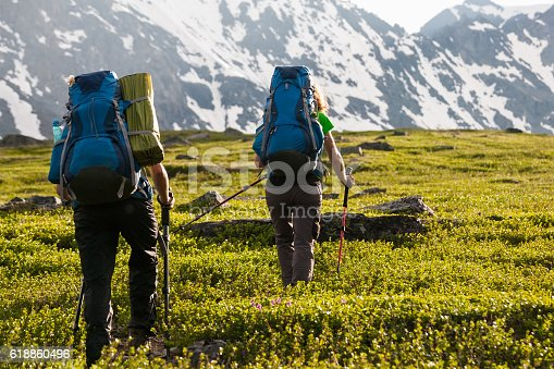 istock Young people are hiking in highlands of Altai mountains, Russia 618860496