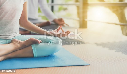 istock Young people are meditating on colorful tires for good health. 871288018