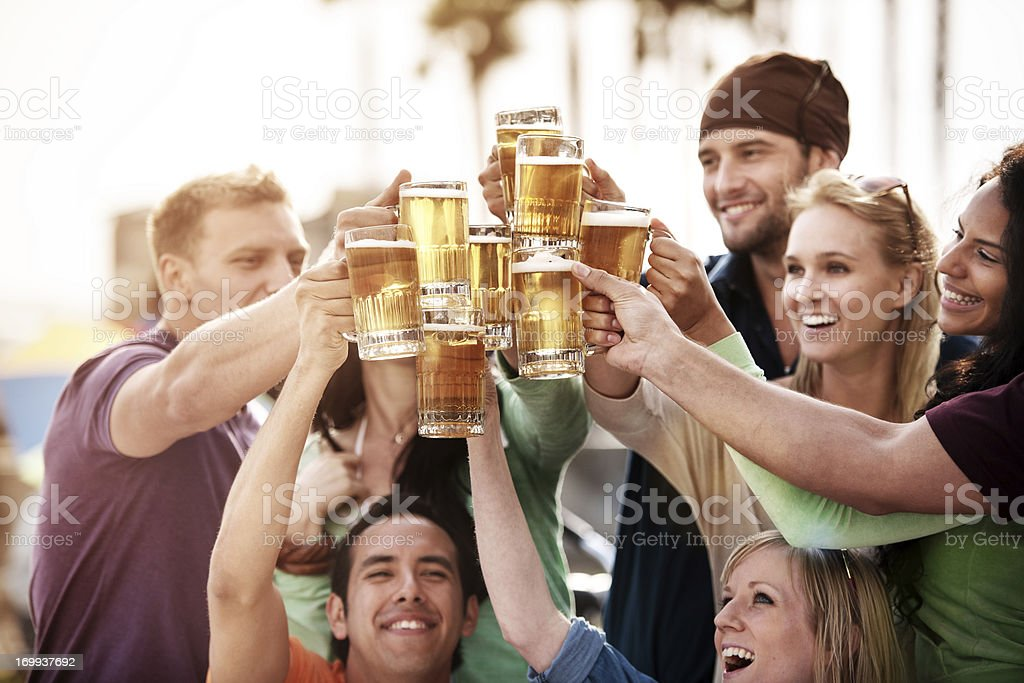 Young people at bistro having beer royalty-free stock photo