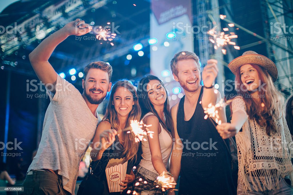 Young people at concert. stock photo