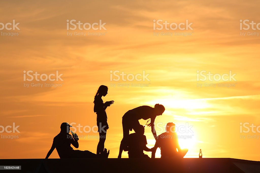 young people at sunset stock photo
