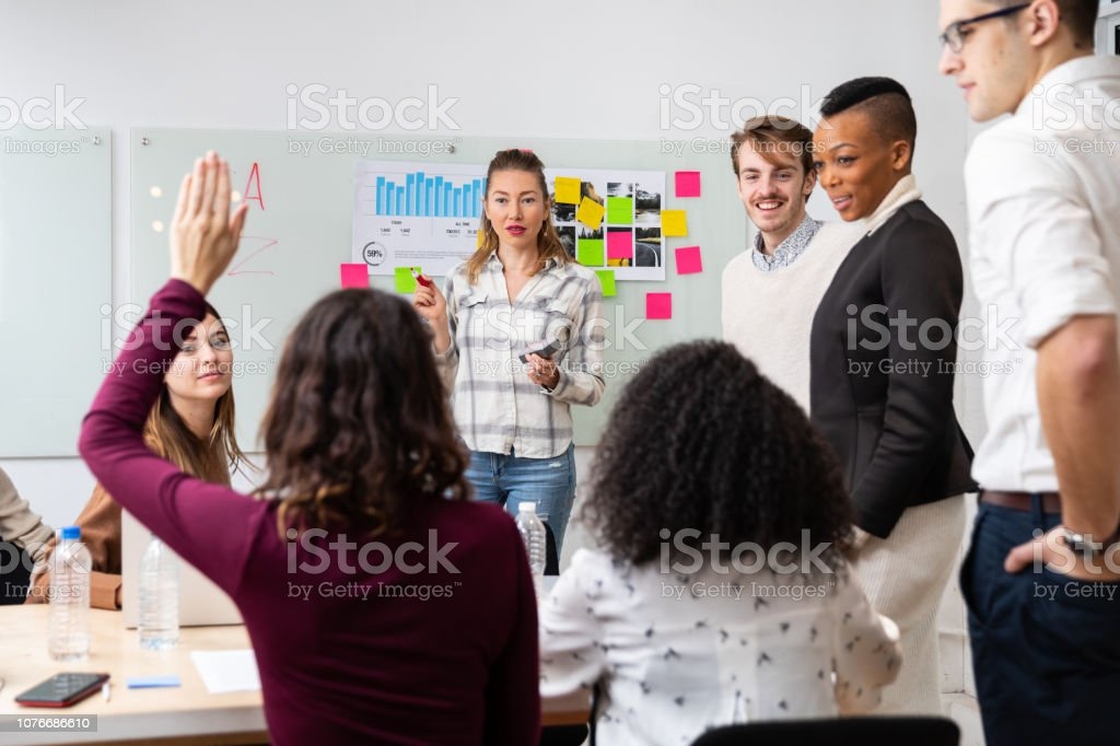 Young people at work in New York office stock photo