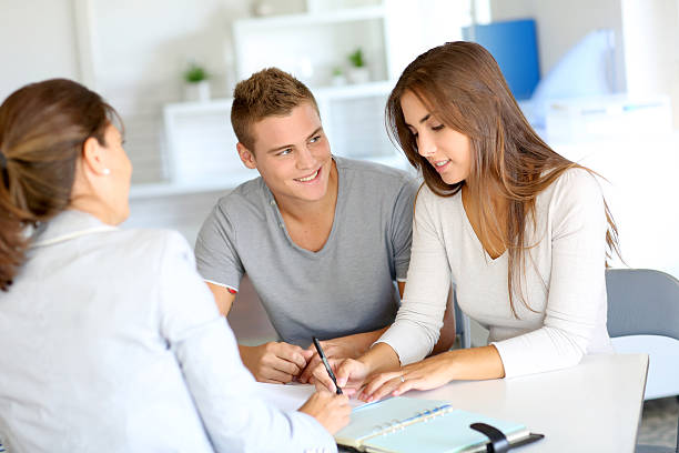 Young people buying house stock photo