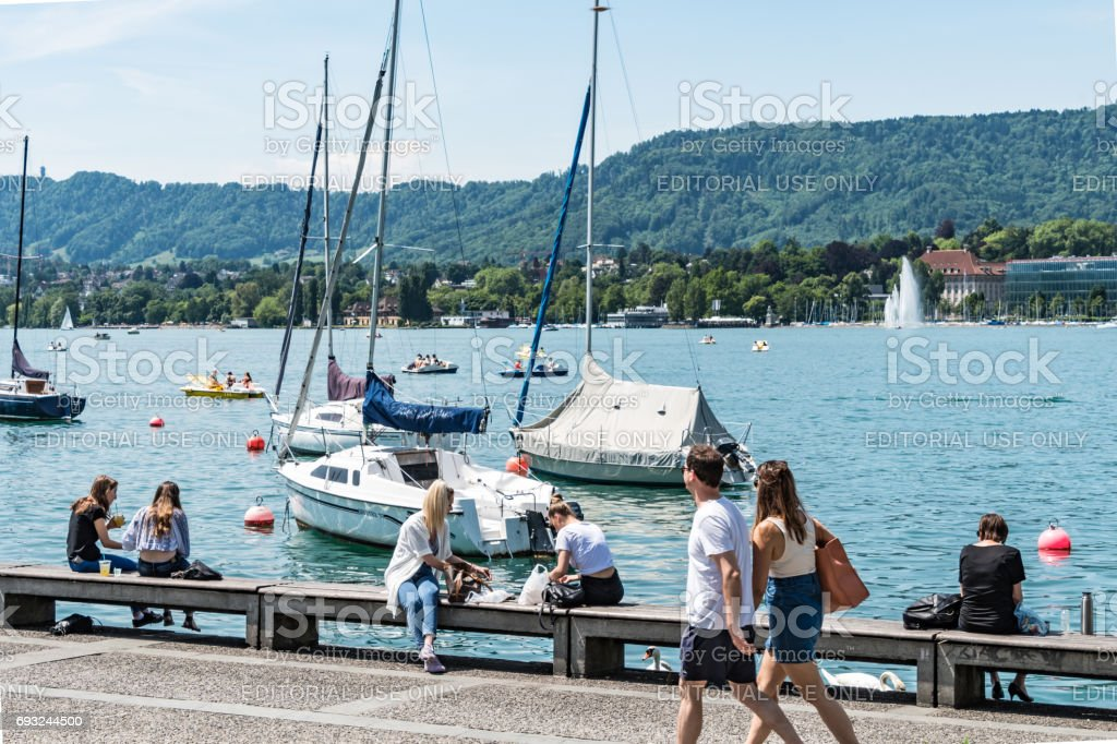 Young people by the side of Lake Zurich stock photo