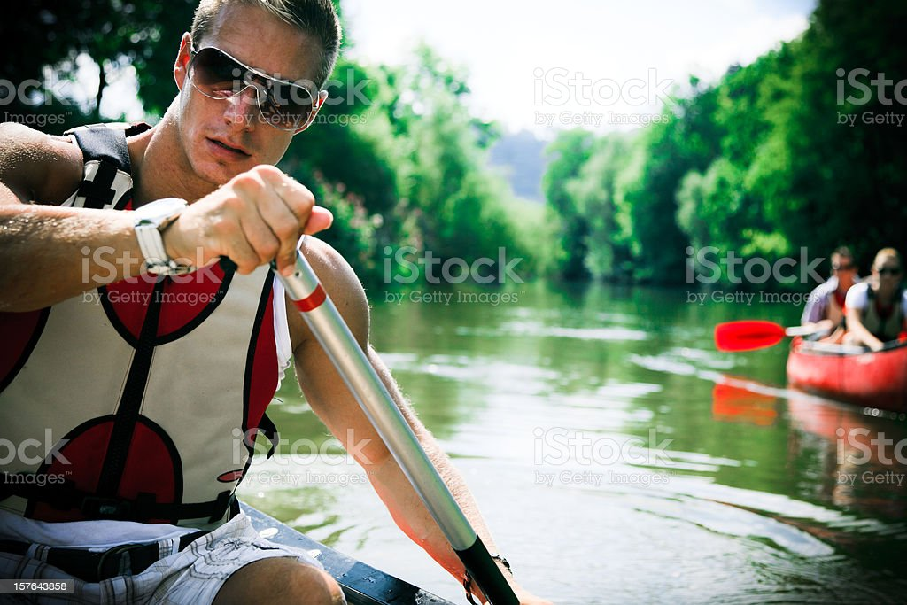 young people canoeing royalty-free stock photo
